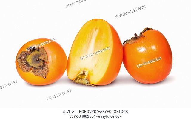Two Whole And One Half Persimmons Isolated On White Background