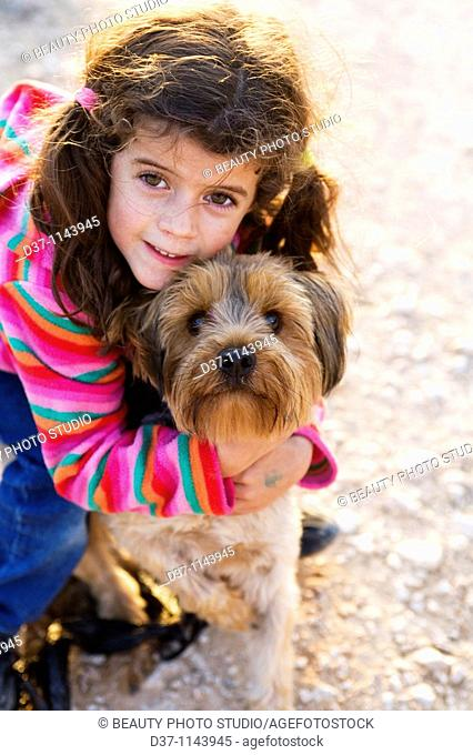 Little girl with a Yorkshire Terrier dog