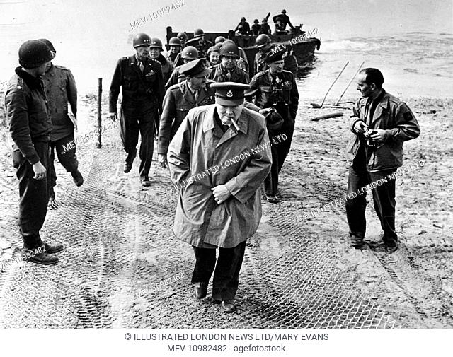 British Prime Minister, Winston Churchill, on the German-held east bank of the Rhine, with Field Marshall Montgomery (in beret) and Field Marshall Brooke...
