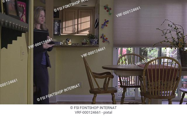 MS, PAN, real estate agent showing the interior of a home to a woman