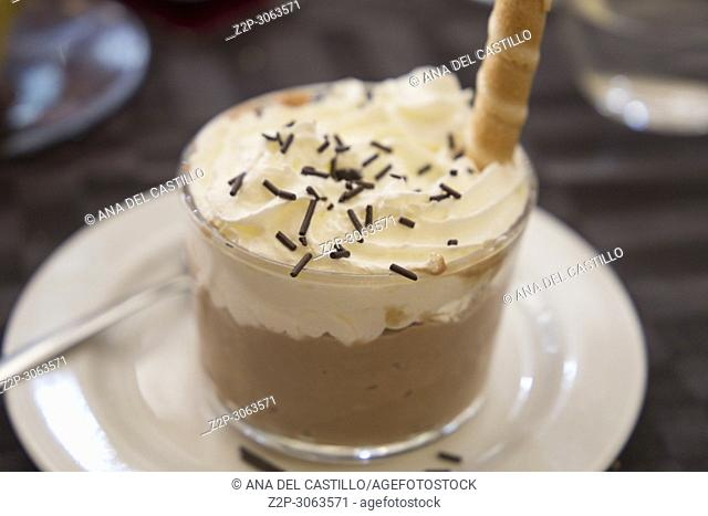 Hazelnut mousse with cream on glass for dessert