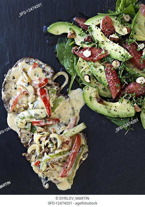 Scaloppine boscaiola with an avocado salad