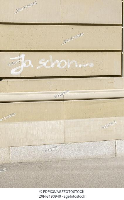 """""""""""ja schon. . . """",""""yes but . . . ,"""" graffito on the wall of a building, stuttgart, baden-wuerttemberg, germany"