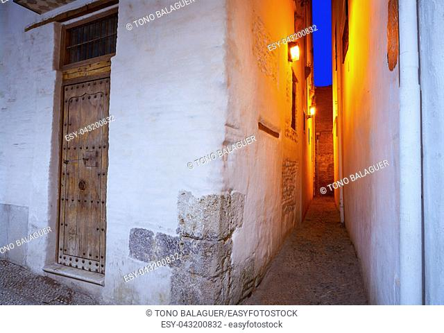 Albaicin of Granada narrow street at sunset of Andalusia muslim Spain