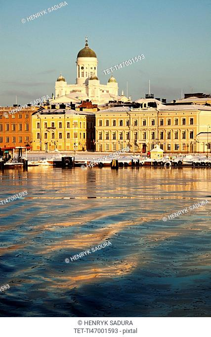 Finland, Helsinki, Harbor and cathedral at sunset