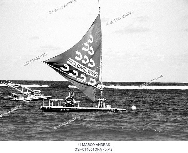 a raft boat sailing at pernambuco sea