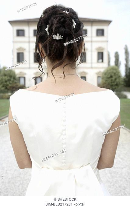 Rear view of Caucasian bride in wedding gown