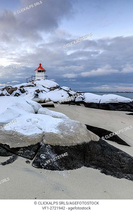 The blue arctic dusk on the lighthouse surrounded by snow and icy sand Eggum Vestvagoy Island Lofoten Islands Norway Europe