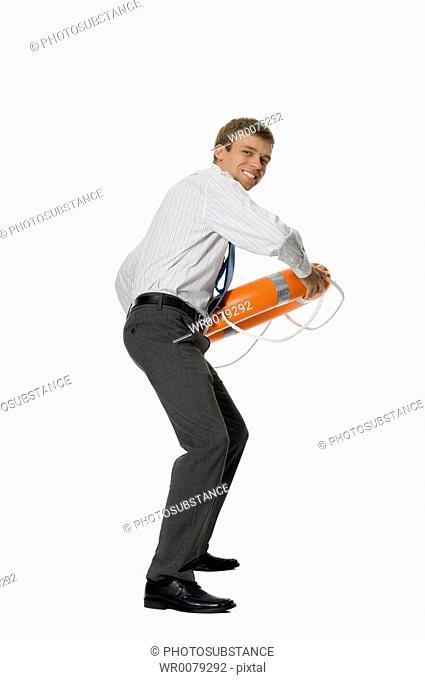 Businessman throwing life buoy