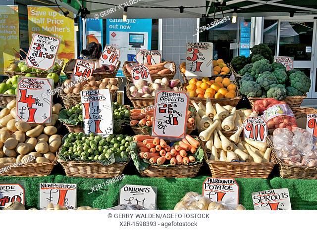 Fresh vegetables for sale on market stall, Southampton, England