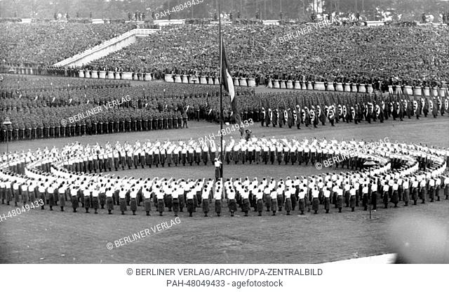 Nuremberg Rally 1938 in Nuremberg, Germany - Roll call of the Reich Labour Service (RAD) in front of the grandstand on Zeppelin Field at the Nazi party rally...