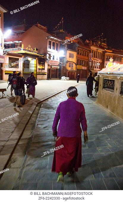 Kathmandu Nepal old woman walking around the Boudhanath Stupa in the early morning 9