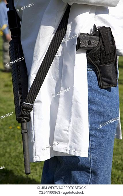 Alexandria, Virgina - Pro-gun activists openly carry firearms in a pro-gun rally at Fort Hunt One participant was a medical doctor wearing a lab coat and...