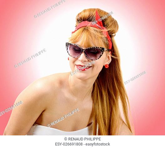 portrait of a young woman in retro style with sunglasses