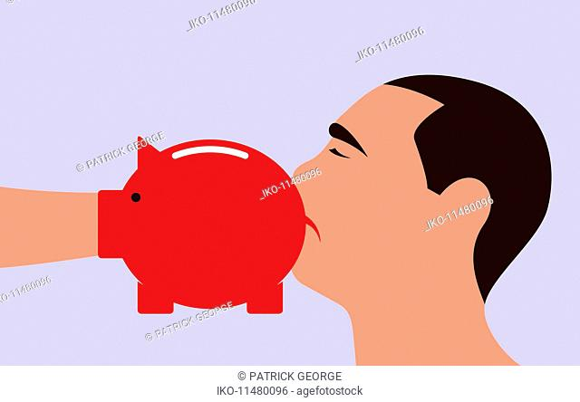 Man being punched by piggy bank boxing glove