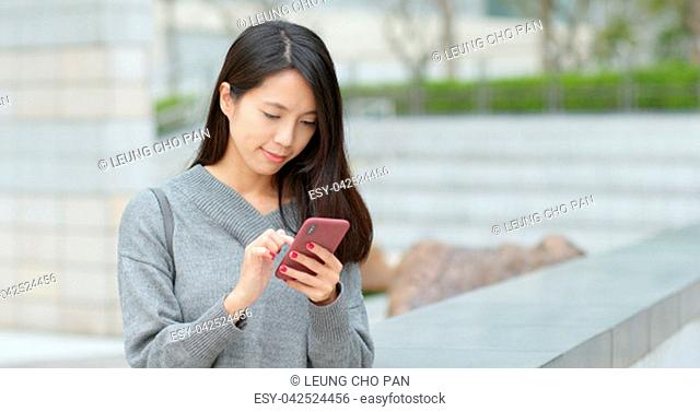 Woman sending audio message on cellphone