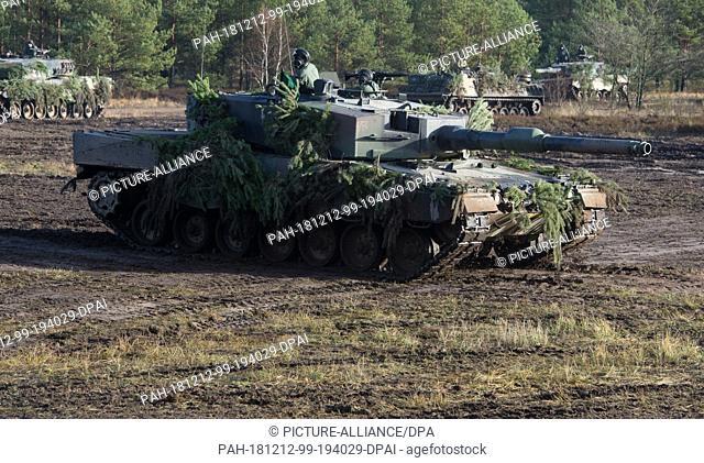 12 December 2018, Mecklenburg-Western Pomerania, Torgelow: A Leopard 2 main battle tank drives on the Jägerbrück military training area