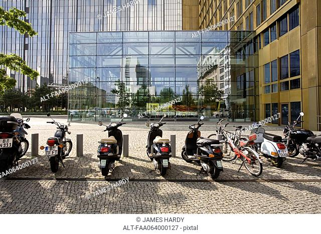 Germany, Berlin, mopeds parked in front of Axel Springer publishing house