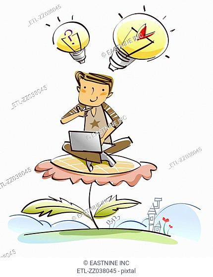 Man sitting on a flower and using a laptop
