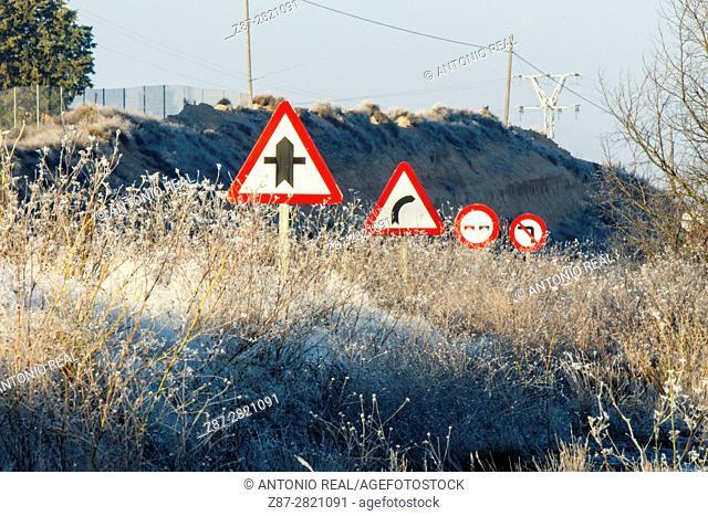 Frozen vegetation and road signs. Almansa. Albacete province. Spain