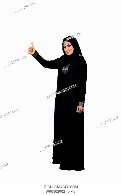 Arab woman giving a thumbs up sign