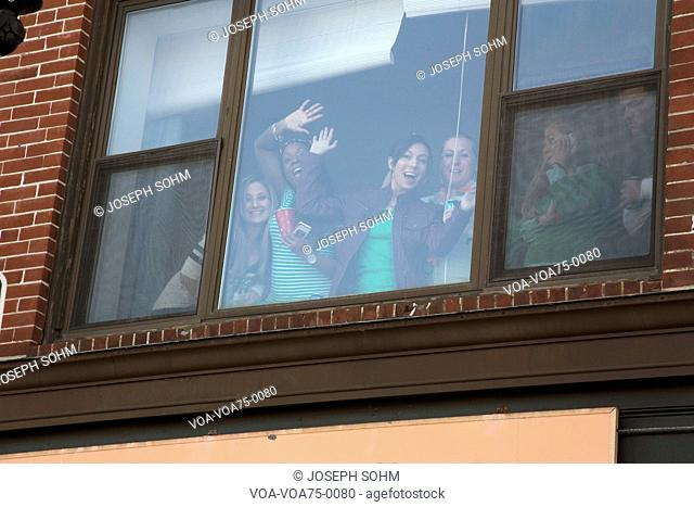 Enthusiastic college girls in window, St. Patrick's Day Parade, 2014, South Boston, Massachusetts, USA