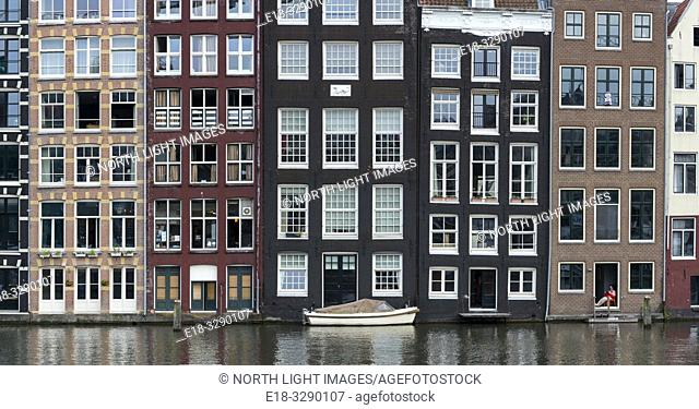 Netherlands, Amsterdam. Classic Dutch housing alongside a canal