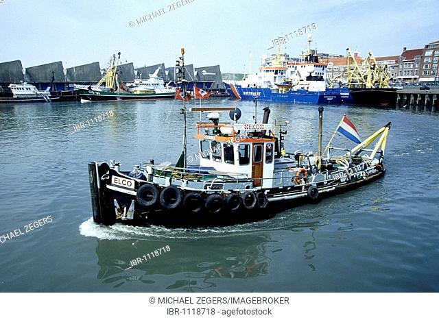 Black harbour boat, fishing port of Scheveningen, seaside resort, part of Den Haag on the Dutch North Sea Coast, South Holland province, Netherlands