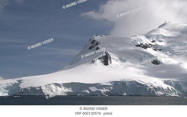 Snow capped Antarctic mountain. Waterboat Point, Paradise Bay