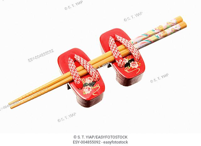 Chopsticks and Miniature Clogs on White Background