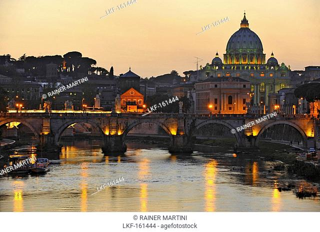 Ponte Sant'Angelo at dusk, with St. Peter's Basilica in the background, Rome, Italy