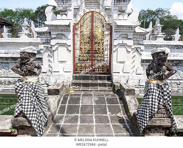 Temple gate and guardians, Denpasar, Bali, Indonesia, Southeast Asia, Asia