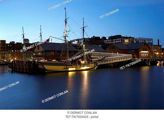 Tall ship and museum at dawn