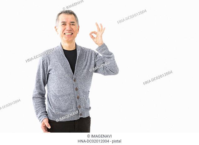 Senior man with OK gesture