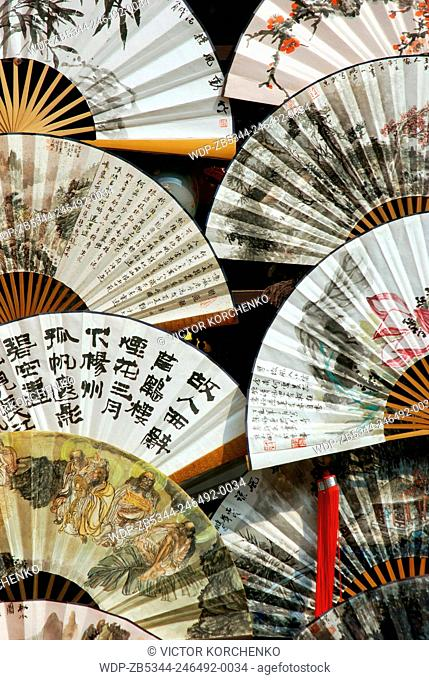 Chinese fans displayed in a window of an antique store on Liulichang historical street in Beijing