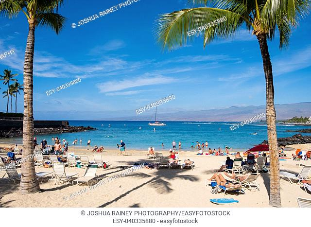 Mauna Lani Beach is very crowded on a warm day on the Big Island of Hawaii. With a limited number of beaches on the Big Island, they tend to get very crowded