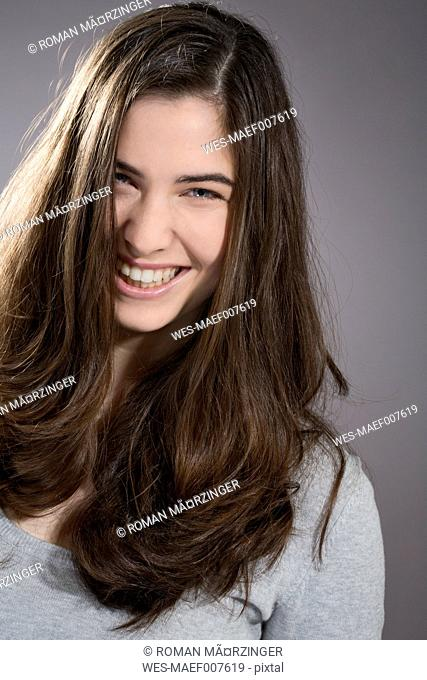 Portrait of smiling young woman, studio shot