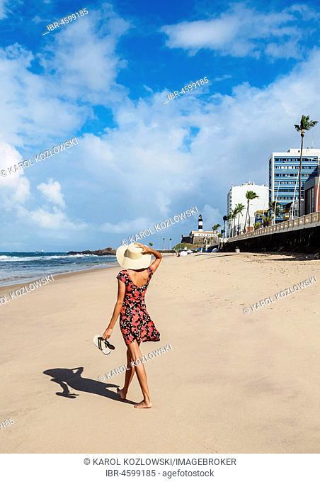 Brazilian Model walking on the Farol da Barra Beach, Salvador, State of Bahia, Brazil