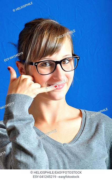 Teen miming a phone with her hand