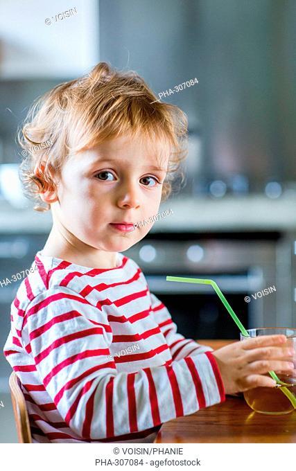 2 year-old boy drinking fruit juice
