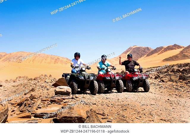 Namibia Northern Desert of Namib Desert tourists 4 wheeling on sand dunes of Hartmann Berge deserted land Hartmann Valley Marienflub