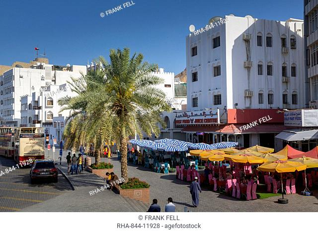 Evening view of restaurants on the Corniche at Muttrah, Muscat, Oman, Middle East