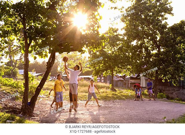 Filipino boys playing basketball  Lapu-Lapu City, Metro Cebu, Mactan Island, Visayas, Philippines