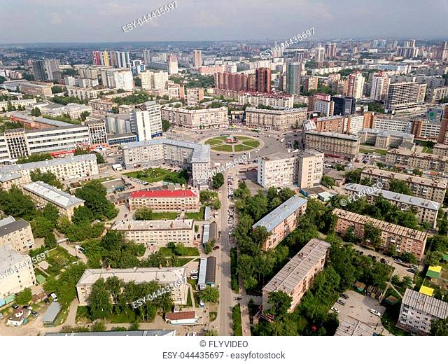 View from the air on old and new russian buildings near the circular motion in the city with a lot of cars. Russian streets, Novosibirsk