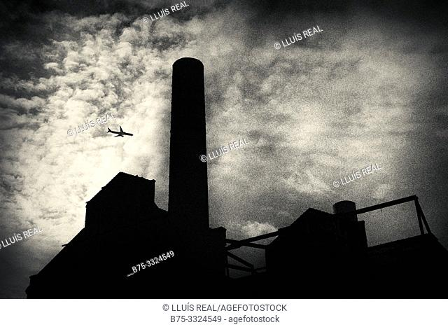Silhouette with clouds and a plane. Lots Road Power Station. Londes, UK, Europe