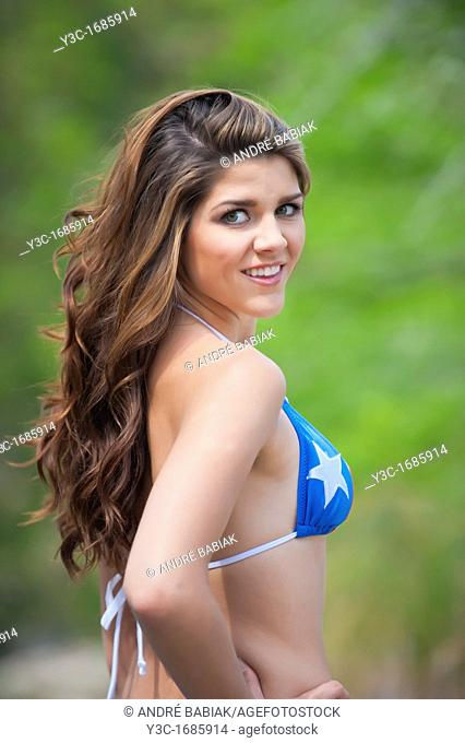 Young attractive woman in Texas theme bikini enjoying nature at a Texas Hill Country river