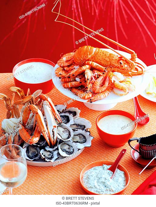 Plates of lobsters, prawns and mussels