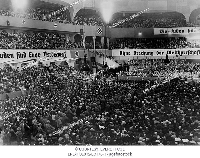 Anti-Semitic rally, with swastikas and anti-Semitic banners, at the massive auditorium of Sportpalast, Berlin, where Nazi propagandist, Julius Streicher