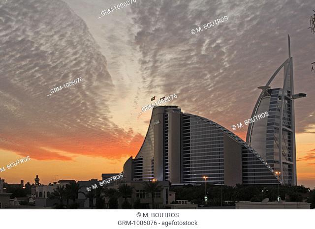 Jumeirah Beach Hotel and Burj Al Arab Hotel at sunset, Dubai, UAE