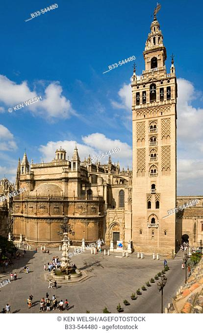 Seville Spain La Giralda tower and cathedral seen across Plaza Virgen de los Reyes